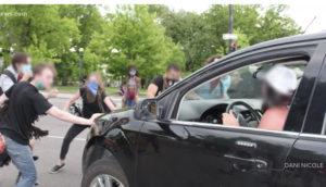 Protesters Attack Car